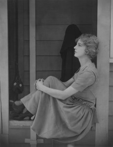 woman in window thinking